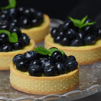 små bagte chessecake med blåbær